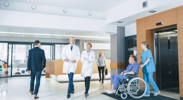 Doctors walking towards air tube station