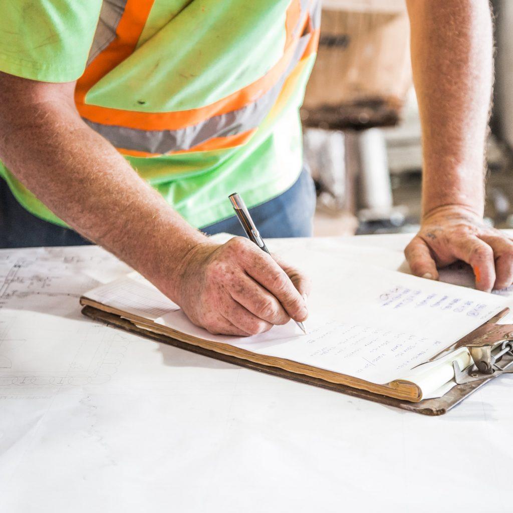 Construction worker reading blueprint